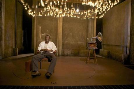 "Teagle F. Bougere plays the title character in ""Invisible Man."" The set evokes the unnamed man's basement lair in Harlem, illuminated by 1,369 light bulbs."